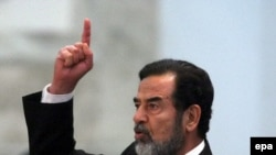 Saddam Hussein reacts to his death sentence at his trial in Baghdad on November 5, 2006.