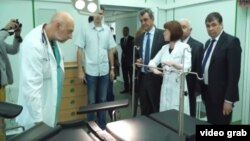 Sevastopol Governor Sergei Menyeilo (fourth from right) and the city's health department chief, Yury Voskanian (far right), attend the official opening of a new hospital operating theater on May 18.