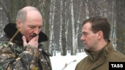 Lukashenka and Medvedev at a meeting in March
