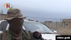 A screen capture from a Kurdish news channel of an American said to be fighting alongside Kurdish militia against Islamic State (IS) group in northern Syria.