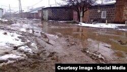 Armenia -- A muddy street in Gyumri.