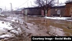 Armenia -- A muddy street in Gyumri, December 2014.