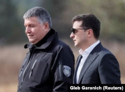 Despite talk from President Volodymyr Zelenskiy (right) of political consequences, Arsen Avakov continues as minister.