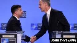 NATO Secretary-General Jens Stoltenberg (right) Ukrainian President Volodymyr Zelensky give a press conference after their bilateral meeting in Brussels on June 4.