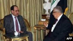 Ирак премьер-министрі Нури әл-Малики (сол жақта) және Ирак президенті Жалал Талабани. Ирак, 19 қыркүйек 2012 жыл.