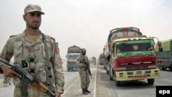 Pakistani soldiers patrol near the Afghan border.
