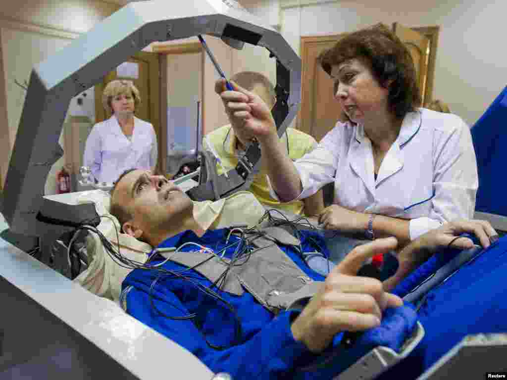 NASA astronaut Rick Mastracchio participates in a training exercise in a centrifuge at the Star City space center outside Moscow. Mastracchio is scheduled to be part of a mission to the International Space Station that will launch in November. (Reuters/Sergei Remezov)
