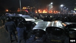 Armenian demonstrators clash with police during a mass protest outside the Russian consulate in Gyumri on January 15.