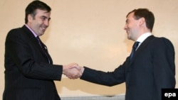 Georgia's Mikheil Saakashvili (left) meets Russian President Dmitry Medvedev in St. Petersburg in June