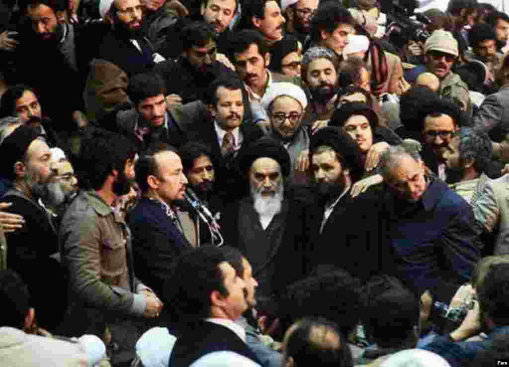 "Behind Khomeini (in glasses) is Sadegh Khalkhali, known as ""the hanging judge,"" who was put in charge of the revolutionary courts (Fars) - In the late 1970s, several events brought Khomeini to attention as the center of opposition in Iran. The popular and moderate Islamist Ali Shariati died (allegedly killed by the shah's secret police), removing a potential rival. In October 1979, Khomeini's son, Mustafa, died and was proclaimed a ""martyr"" by the opposition."