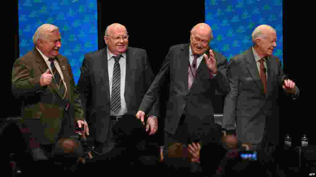 Nobel Peace Laureates (left to right) Lech Walesa, Mikhail Gorbachev, Frederik Willem de Klerk, and Jimmy Carter at a panel discussion at the University of Illinois in Chicago on April 23, 2012.