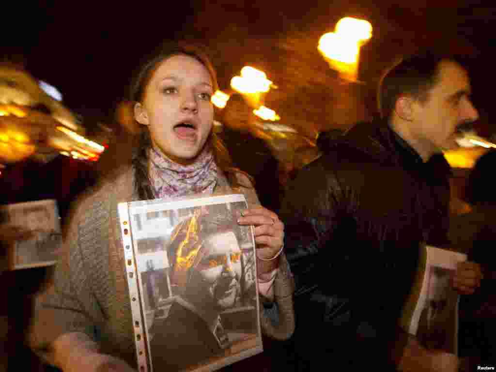 A woman shouts slogans during a rally in Minsk on November 16. People gathered with portraits of missing and imprisoned public figures as they took part in the rally. Photo by Vasily Fedosenko for Reuters