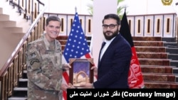 FILE: Afghan National Security Adviser Hamdullah Mohib (L) with General Joseph Votel, head of U.S. Central Command (CENTCOM) in February.