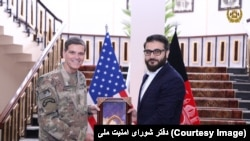 U.S. Central Command head Joseph Votel and Afghanistan security adviser Hamdullah Mohib on February 20