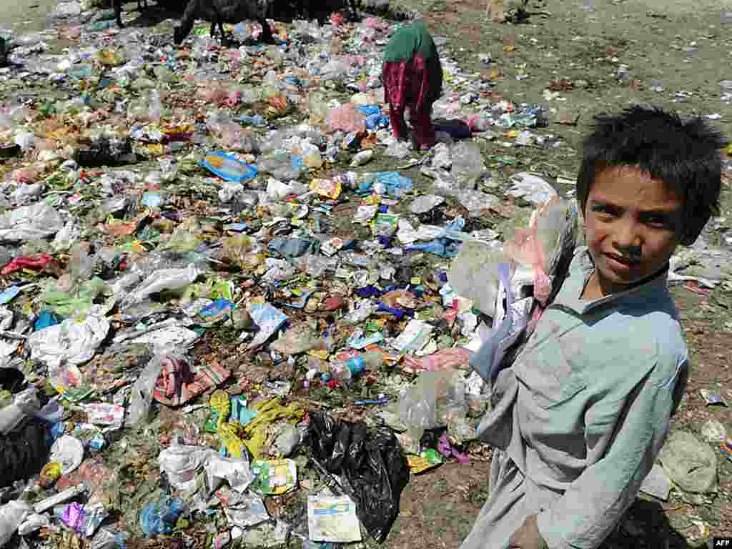 Afghan children search for plastic and scrap metal at a dump in Kabul. Thousands of homeless children in Afghanistan make a living by scavenging for items to sell or to burn to keep warm in winter. Photo by Marai Shah for AFP