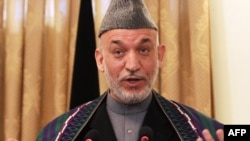 Afghan President Hamid Karzai at a press conference in Kabul on December 8.