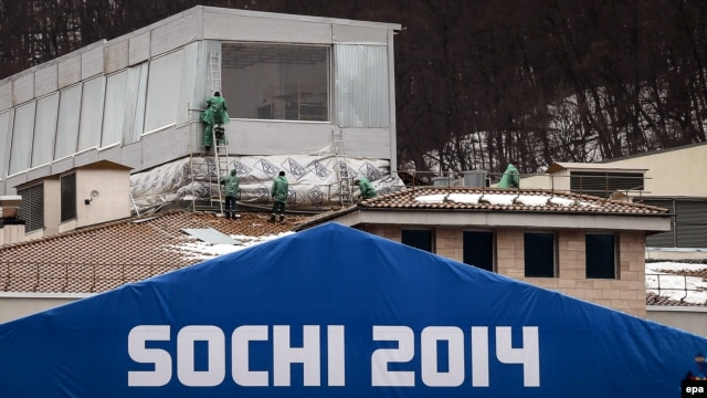 Workers are seen at the construction site of an Olympic venue building in Krasnaya Polyana on January 27.