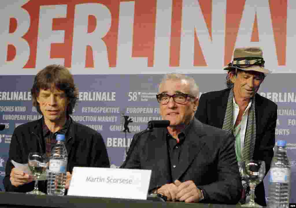"Jagger (left), Richards (right), and U.S. film director Martin Scorsese discuss Scorsese's Rolling Stones concert film ""Shine A Light"" at the Berlin International Film Festival in 2008."