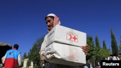 An Afghan man receives aid from the International Federation of the Red Cross and Red Crescent Societies (file photo).