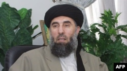 In this file photo taken, 17 October 2001, Gulbuddin Hekmatyar, a former Afghan warlord in exile in Iran, gives an interview to AFP in Tehran. As stated in a report released, 21 November 2004, Warlord Gulbuddin Hekmatyar, who is wanted by Washin