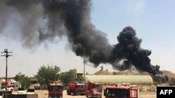 Дым над городом в иракской провинции Киркук
