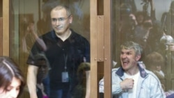 Platon Lebedev (right) with Mikhail Khodorkovsky in the dock during a court session in Moscow in May.
