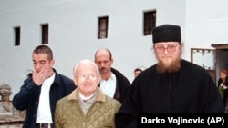 Kosovo Liberation Army political leader Adem Demaci (left) meets with father Sava Janjic at the Decani monastery in October 1998.