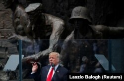 Trump speaks in front of the Warsaw Uprising Monument at Krasinski Square in Warsaw on July 6.