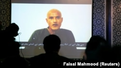 Former Indian Navy officer Kulbhushan Sudhir Jadhav is seen on a screen during a news conference in Pakistan.