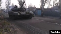 A tank rumbles through the streets on the outskirts of Donetsk on November 8.