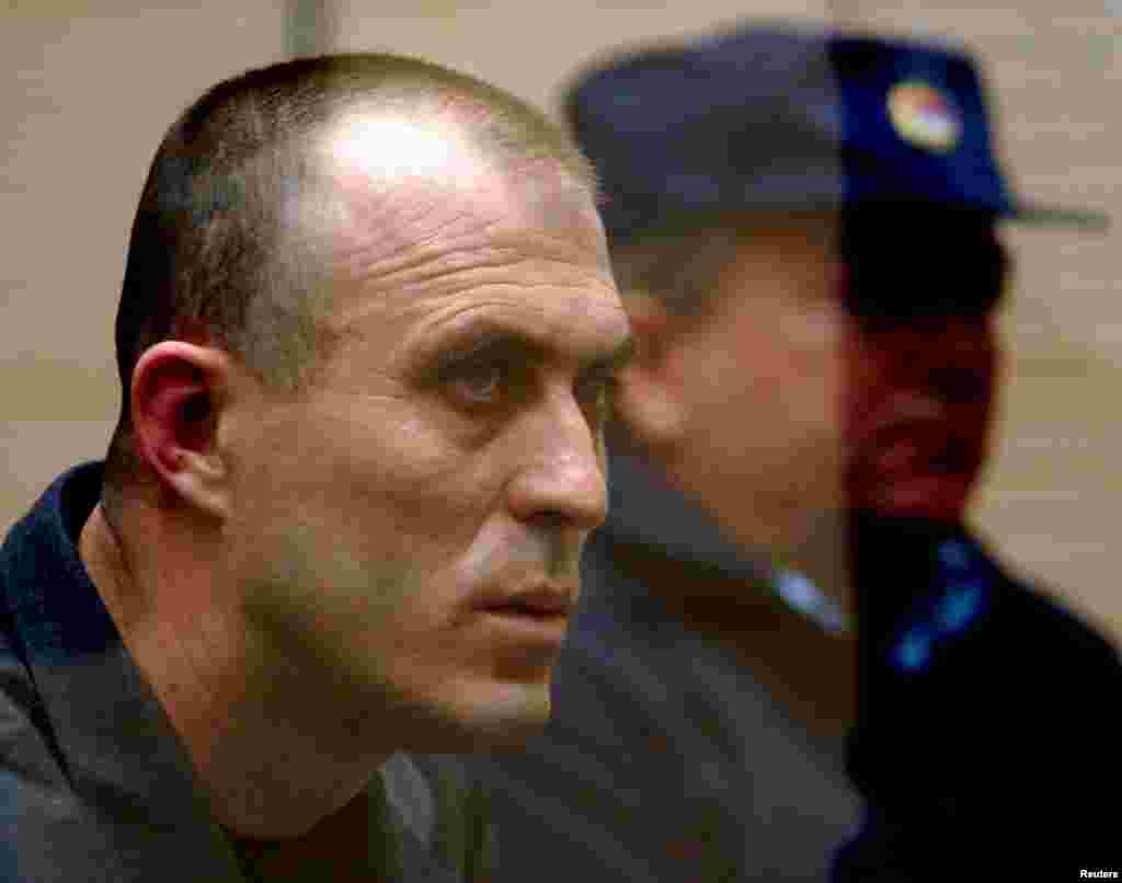 Zvezdan Jovanovic, a former deputy commander of the elite Red Berets secret service unit, stands trial in Belgrade in 2003 for firing the bullets that killed Djindjic. He and another 11 men have been convicted of collaborating in the assassination plot.