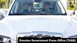 Turkmen President Gurbanguly Berdymukhammedov (right) with then-Russian Prime Minister Dmitry Medvedev in Turkmenbashi in August 2019