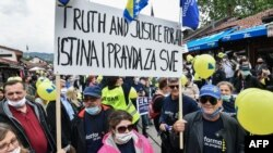 Protesters gather during a rally in Sarajevo on May 30, 2020, to protest against the allegedly high level of corruption in the Bosnian government.