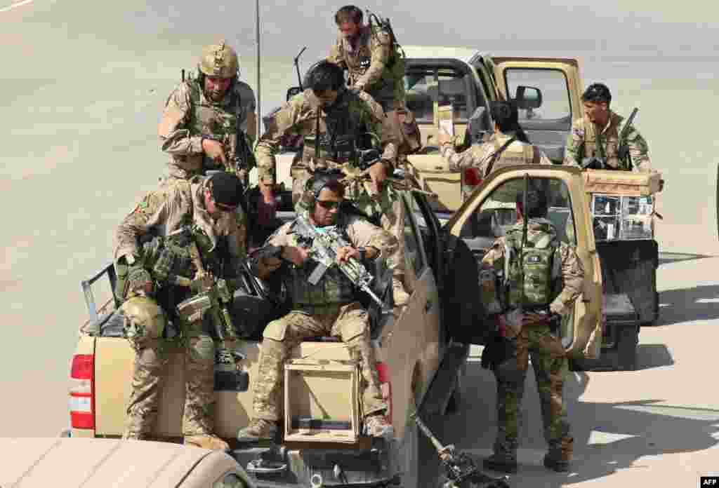 Afghan special forces arrive at the Kunduz airport on September 29 as they prepare to launch a counteroffensive to retake the city from Taliban insurgents.