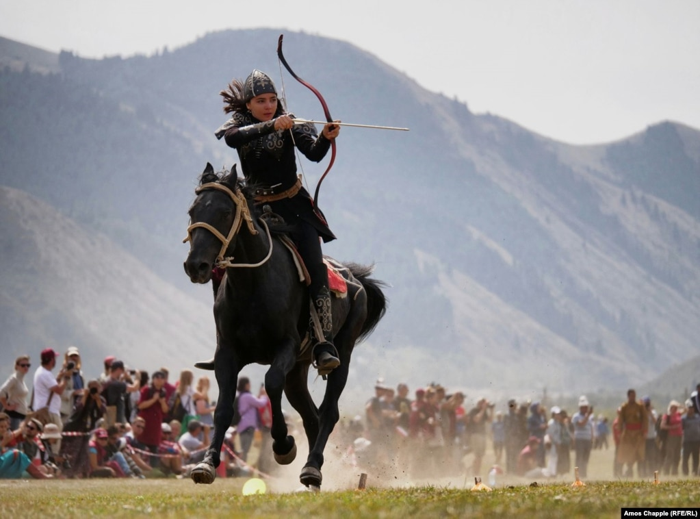 Turkey's Janset Genel in full flight during the mounted archery event, which the 18-year-old would go on to win, at the third World Nomad Games in Cholpon-Ata, Kyrgyzstan. (RFE/RL/Amos Chapple)
