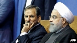 Iranian President and Hassan Rohani (R), with vice-president Eshaq Jahangiri. File photo