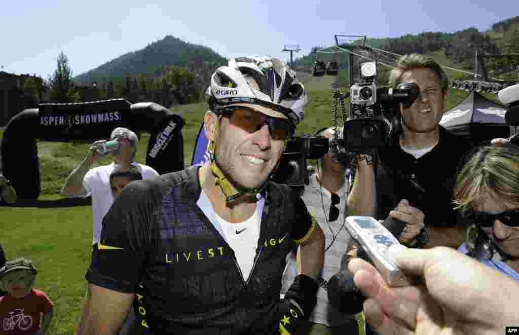 """U.S. cyclist Lance Armstrong finishes the Power of Four Mountain Bike Race in Aspen, Colorado, in August. In October, Armstrong was banned for life and stripped of his seven Tour de France titles after the U.S. Anti-Doping Agency declared that he was a""""serial cheat who led the most sophisticated, professionalized and successful doping program that sport has ever seen.""""(AFP/Riccardo Savi)"""