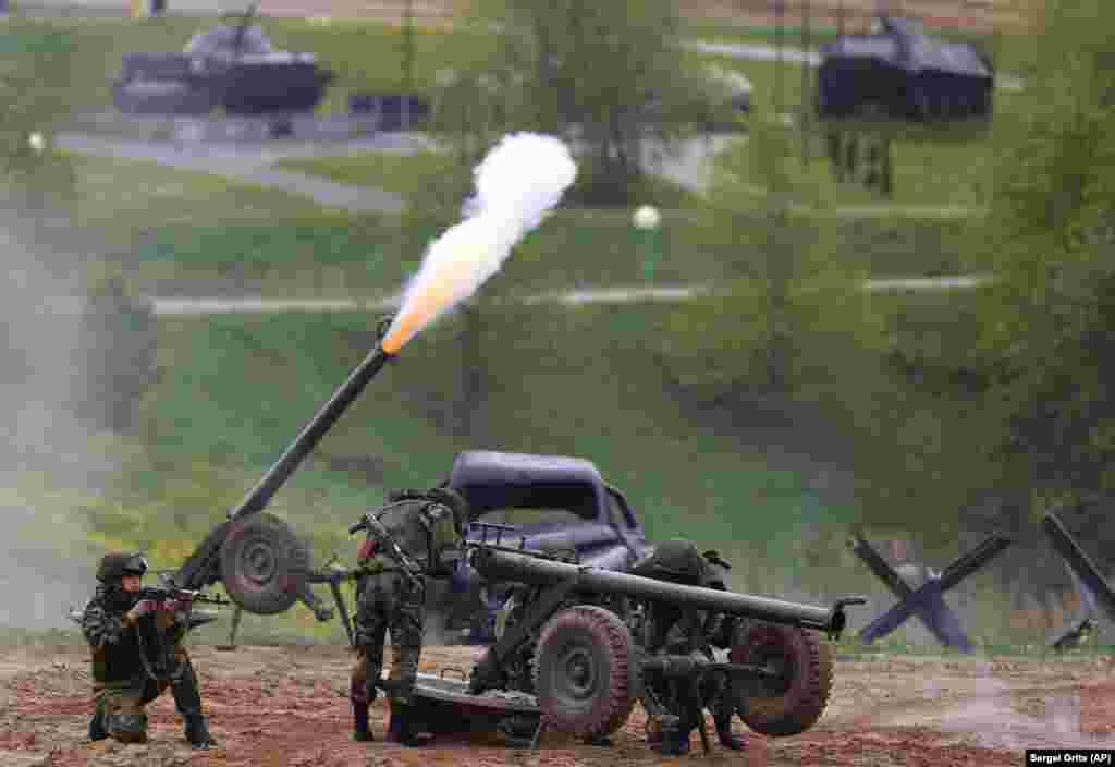 Participants in a Belarusian military show perform near the village of Horoshki on the outskirts of Minsk. (AP/Sergei Grits)