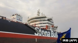 An image grab from Iranian Broadcasting on July 22 shows the Iranian Revolutionary Guards Corps patrolling the oil tanker Stena Impero anchored off the Iranian port city of Bandar Abbas.