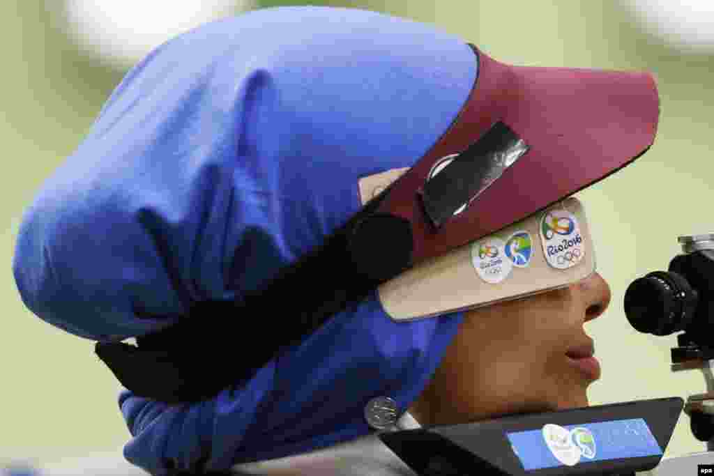 Elaheh Ahmadi of Iran takes aim during qualification for the women's 10-meter air rifle competition.