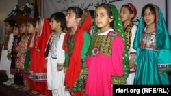 Afghan children singing the national anthem at an event for World Children's Day. Under the new ban by the Education Ministry, schoolgirls over a certain age will only be permitted to sing at public events if all participants are female.(file photo)