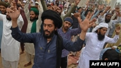Supporters of the hard-line Tehrik-e Labaik Pakistan chant slogans as they block a street during a protest after their leader was detained following his calls for the expulsion of the French ambassador, in Lahore on April 16.