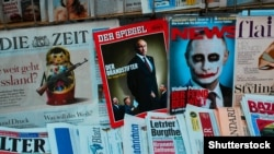 Avstriyada bir jurnalın üzündə Putin-in fotosu