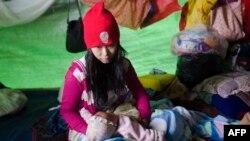 یکی از آوارگان درگیریهای شمال میانمار روز شنبه ۲۲ اردیبهشت در ایالت کاچین