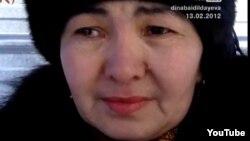 Жаңаөзен оқиғасының ұйымдастырушысы ретінде айыпталып, қамауда жатқан Нарын Жарылғасыновтың әпкесі Нұрқия Бекболатова. Жаңаөзен, 13 ақпан 2012 жыл. Дина Байділдаева түсірген видеодан алынған скриншот.
