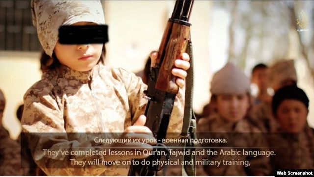 "A grab from the video, titled ""Race Toward Good,"" released via the Islamic State militant group's Al Hayat website, showing Kazakh nationals, including children, in training in Syria."