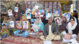 Families of Baloch victims of alleged enforced disappearances inside their protest camp in Quetta, Balochistan.