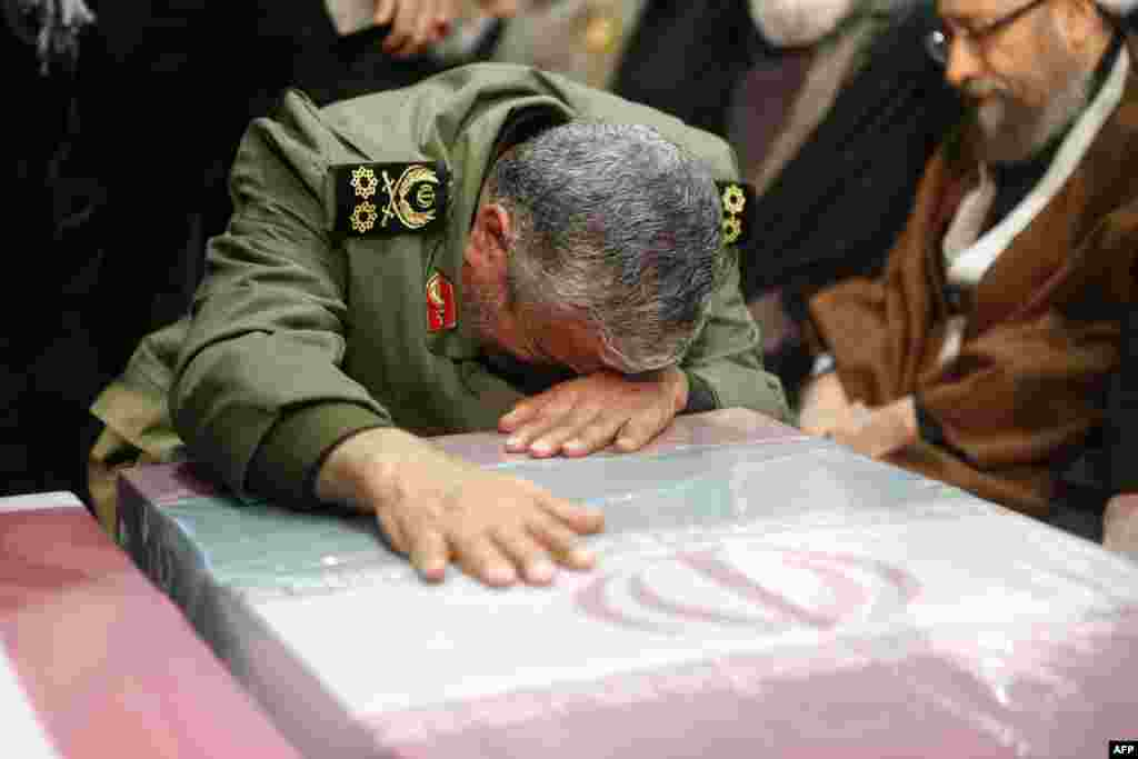 The new Quds Force leader, General Ismail Qaani, wept on the flag-draped coffin of his slain predecessor, Qasem Soleimani.
