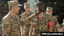 Armenia - Defense Minister Seyran Ohanyan (L) visits an Armenian army base deployed near the border with Azerbaijan, 20Aug2013.