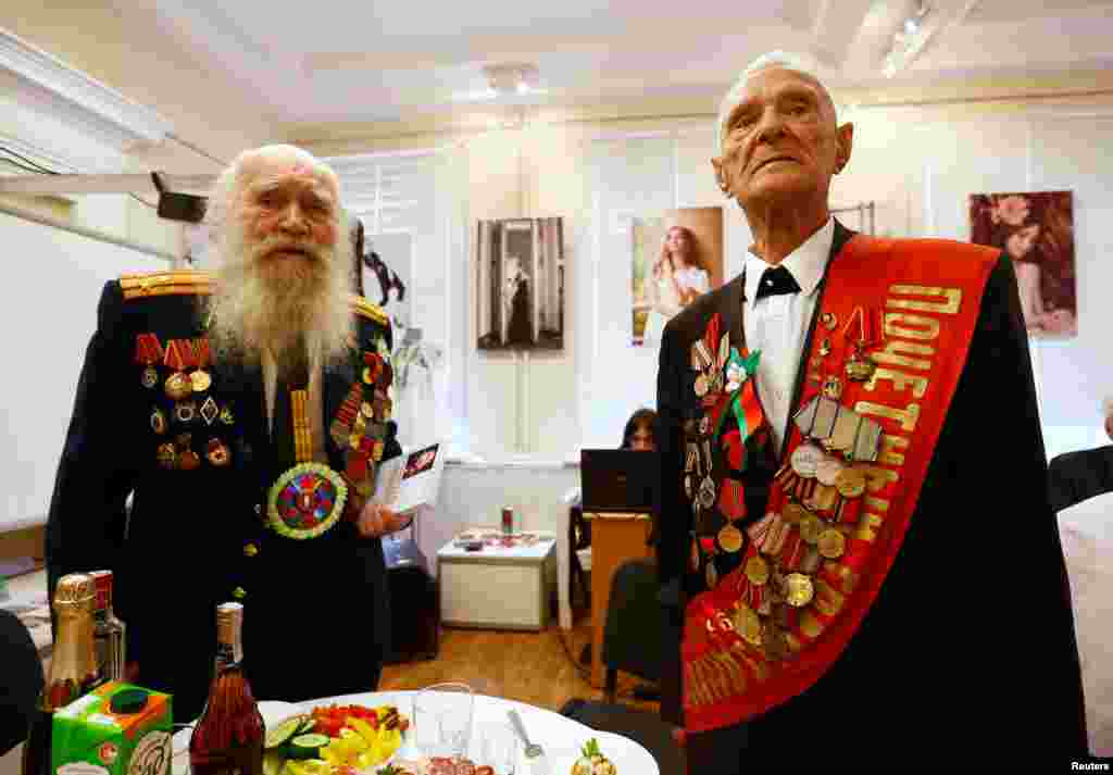 Belarusian World War II veterans Vasily Molodtsov (right) and Nikolay Skatulin pose for a photo during an event to mark the 71st anniversary of the country's liberation from Nazi Germany in Minsk. (Reuters/Vasily Fedosenko)